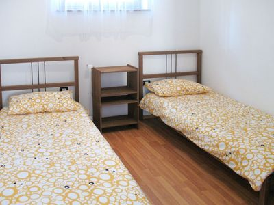 Photo for Nice apartment in villa for 12 guests with WIFI, pool, TV, balcony, pets allowed and parking