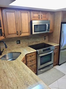 Updated kitchen with granite counter-tops and backsplash.