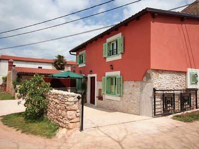 Photo for Modern holiday home for sole use with 2 bedrooms, WiFi, air conditioning, pets allowed, terrace and barbecue