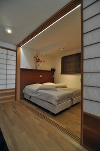 bedroom with handmade Japanese draught screens