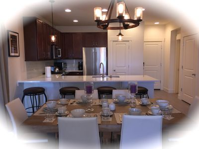 Beautiful dining area, granite counter top and high end kitchen