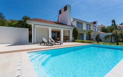 Casa Vidmar up front with its modern mediterranean architecture and heated pool.
