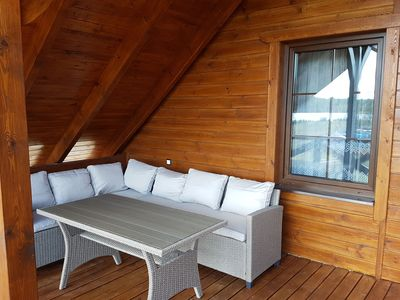 Photo for A comfortable wooden house for 4 people by the lake in Bory Tucholskie