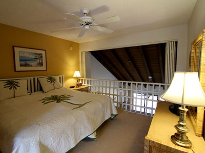 Upstairs Bedroom Overlooking Living Room With Shutters For Privacy