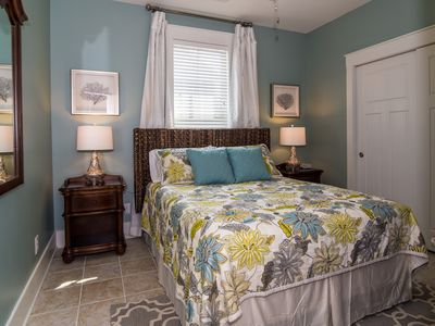 queen bedroom with seagrass headboard new led tv and large closet