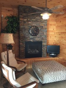 Main floor fireplace. Great place to warm up. Concrete floors so you can keep your gear on.