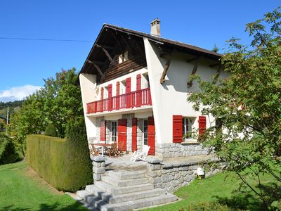 Photo for CHALET on large grounds, 12 persons, living room and terrace overlooking the mountains.