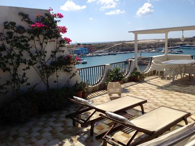 Photo for Lampedusa. Beautiful penthouse with large flowery terrace on the Port of Palm