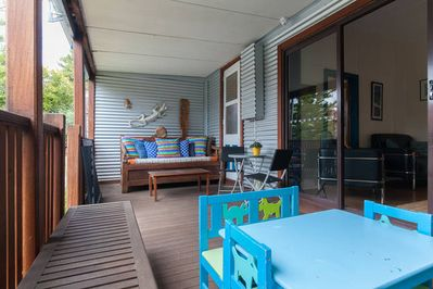 Front deck , day bed, plenty of seating and small table for children
