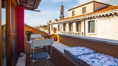 Photo for Loft with beautiful terrace overlooking a canal, at a few minutes walk from Rialto