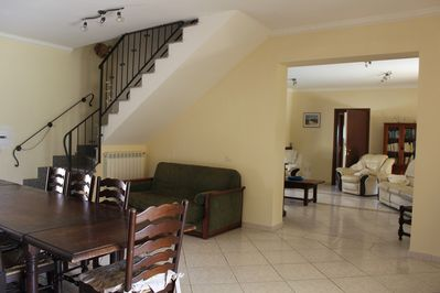 Dining room with stairs leading to upper floor