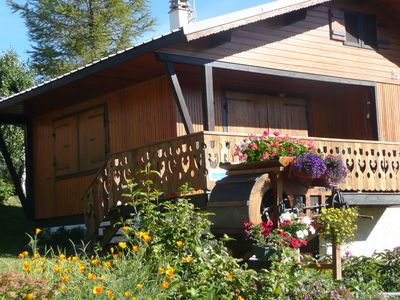 Photo for cozy wooden cottage in LA TOUSSUIRE