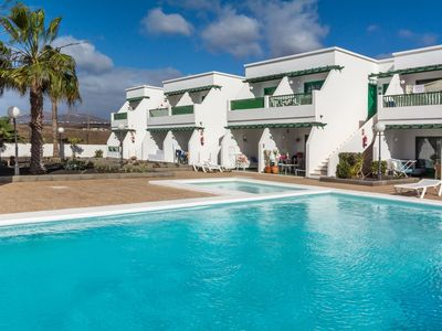 Photo for Modern Apartment Close to the Beach with Wi-Fi, Pool and Patio