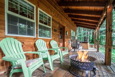 Covered porch off front of the cabin with propane firepit