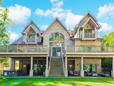 Lakefront home with private dock, fitness room, home theater, and hot tub!