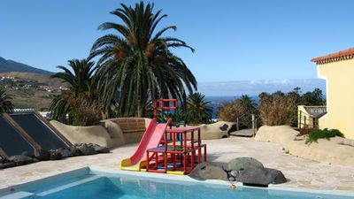 Photo for Palmasol: quiet, central, idyllic garden, swimming pool, children long term rentals available