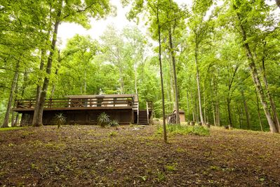 House sits in a secluded wooded area with huge deck