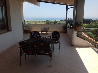 Photo for Penthouse with Panoramic Veranda immersed in Nature, a stone's throw from the Ionian Sea