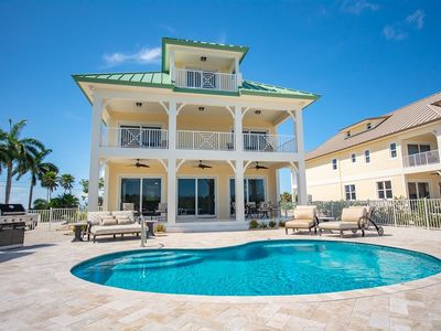 New Luxury Property! Breathtaking Canal Front Pool Home - Sleeps 14