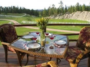 Enjoy the peaceful covered deck and view after a day of sight-seeing