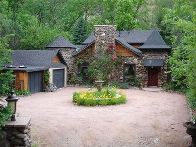 Creekside Chateau,patio overlooks Oak Creek, with steps to directly to the water