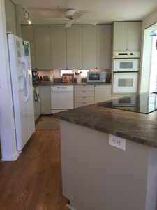 Fully stocked kitchen with granite countertops and new cooktop & microwave.