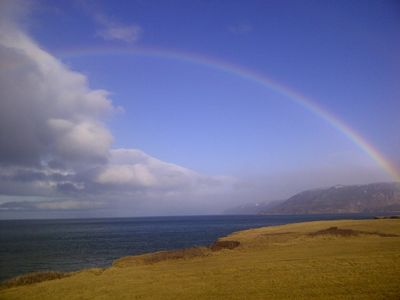 Rainbow over the highlands in fall.