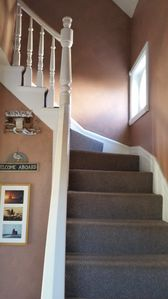 Two tiered staircase from front door foyer