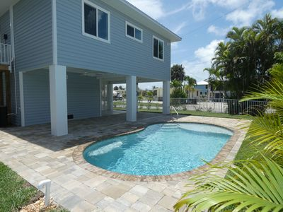 Photo for Brand new, professionally decorated beach paradise w/pool, 2 min. walk to beach