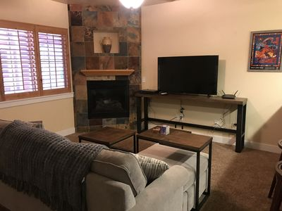 Cozy fireplace and large screen TV