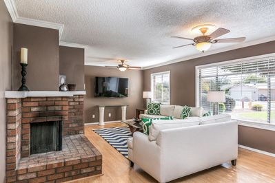 Living Room With 60 Inch Smart Tv & Wood Burning Fireplace