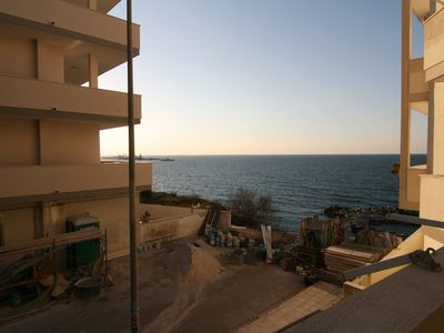 Photo for Cosy Holiday Apartment by the Sea with Air Conditioning and 2 Balconies