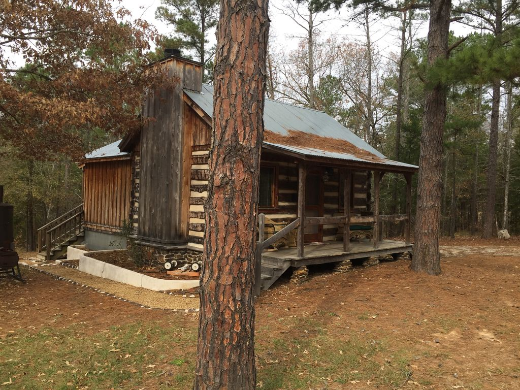 Log cabin in woods with trail and wood fireplace lindale Texas cabins in the woods