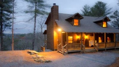 Photo for Luxury mountain cabin sleeps 12  with movie lounge, hot tub, and long range view