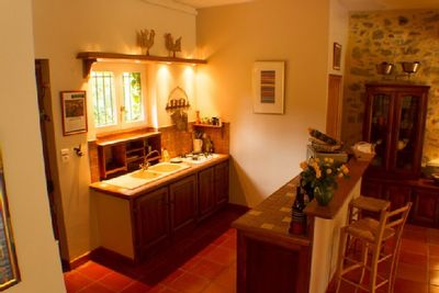 Fully Equipped Kitchen Opens to Dining Area