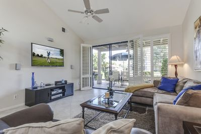 Spacious living room with valuted ceilings, 55 high def tv on swivel mount.