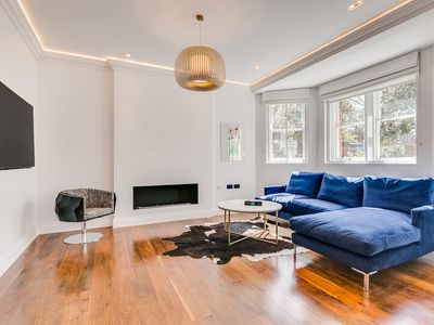 Photo for Newly refurbished high end 3 bed/3bathroom Chelsea flat off the kings road!
