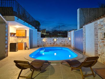 Photo for This 3-bedroom villa for up to 10 guests is located in Pula and has a private swimming pool, air-con