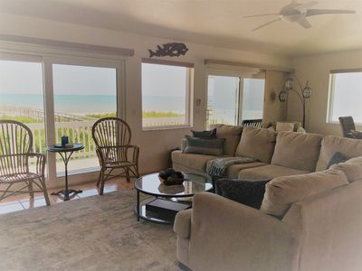 The living room has plenty of seating with gorgeous ocean veiws.
