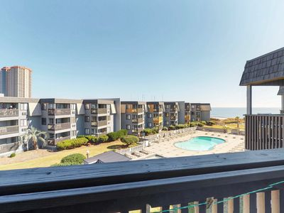 Photo for Oceanview condo with shared pool and oversized balcony, right next to the beach