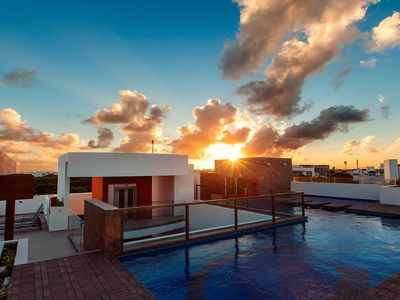 Photo for NEW LISTING! Luxury condo w/ shared rooftop pool, kitchen, balcony - near beach