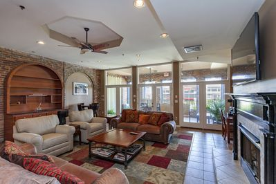 Living room: Two sofas, comfy chairs, 65-inch flatscreen, premium channels