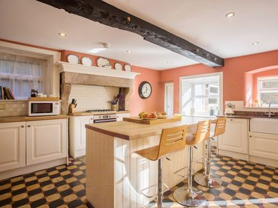 The kitchen is modern yet retains its character