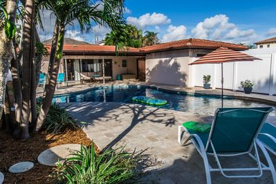 Relax in our uniquely shaped swimming pool surrounded by plumeria and palms