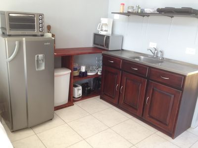 Full studio kitchen with fridge, microwave, toaster oven, 2 burner hot plate, espresso machine, toaster and more