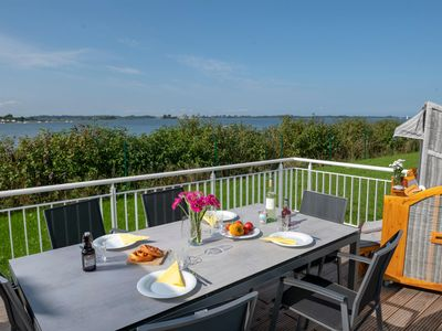 Photo for Exclusive holiday home directly on the Schlei - four levels, four terraces in all directions - all-day sun, private spa area and woodburning stove