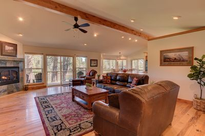 Open living room with view - Welcome to 17051 Upland Road. The most luxurious home at the best price on the Big Deschutes River!