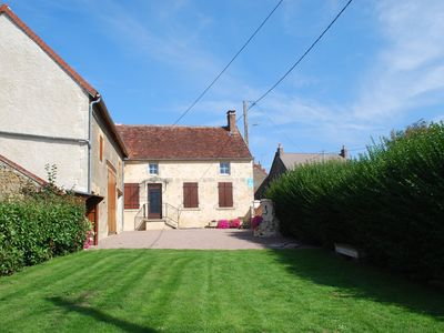 Photo for Charming flowery cottage in the heart of the Monts du Nivernais