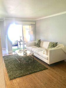 Photo for Stylish condo with pool and jacuzzi. 5 minutes from downtown
