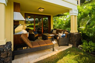 Relax on the private lanai. Lush plants and walkout lawn perfect for kids & yoga